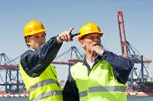 picture of hard_hat  - Two dockers in discussion - JPG