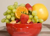 red bowl full of mixed fruits, healthy diet alternative, natural source of vitamins