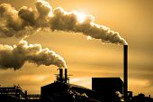 stock photo of belching  - Detail of pollution coming from factory smoke stacks - JPG