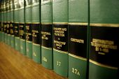 Close up of several volumes of law books of codes and statutes on consumer protection