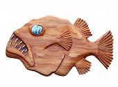 Ugly Wooden Fish with Shell Eye isolated with clipping path