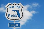 Florida Road Trip Highway Sign, Florida Map And Text Road Trip On A Highway Sign With Sky Background poster