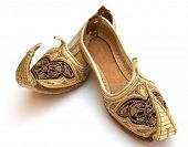 A pair of miniature Persian or Arab shoes in the Aladdin style.