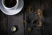 Old Watches, Clockwork - Gears, Screws, A Cup Of Unfinished Coffee On Wooden Planks. Good Idea Vinta poster