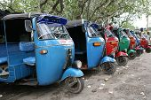 Tuk-tuk minicabs waiting for business in Sri Lanka. Editorial only.