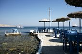 A Greek taverna, that includes a table in the middle of the sea, near Akrotiri, Santorini