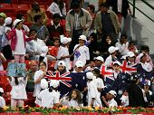 Alicia Molik's fans wave the Australian flag during her match against Justine Henin at the Qatar Tot