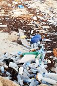Rubbish washed up on the shore in the Arabian Gulf. Mineral water bottles, shampoo bottles and old t