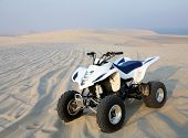 A quadbike in the middle of the Qatari desert.