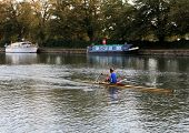 An oarsman powers his skiff down the Cherwell in Oxford.