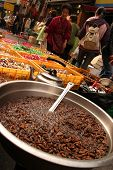Hot, stewed silkworm larvae and other delicacies on sale at a street market in Seol, South Korea.