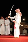 Members of a Qatari folk troupe performing the traditional Bedouin sword dance, the Arda, during Doh