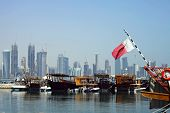 A view of the dhow harbour in Doha, Qatar, with the high-rise development across Doha Bay, a fusion