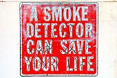 stock photo of fire-station  - Old smoke detector sign on a old fire station wall - JPG