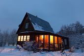 Country house (dacha) in winter dawn. Moscow region. Russia.