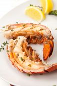 picture of lobster tail  - Closeup of delicious grilled lobster tails served with asparagus and bearnaise sauce - JPG