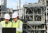 image of refinery  - engineer oil refinery discussion with laptop on location site - JPG