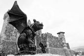 Gargoyle And Castle In Black And White