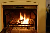 image of log fire  - Fireplace with wood and fire closeup shoot - JPG