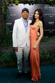 NEW YORK - MAY 29: Russell Simmons and Hana Nitsche attend the premiere of