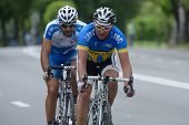 KIEV, UKRAINE - MAY 24: Sergey Krasnov, Ukraine (in front) and Tai Gabay, Israel in the bicycle racing Race Horizon Park in Kiev, Ukraine on May 24, 2013