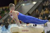 KIEV, UKRAINE - MARCH 31: Filip Ude, Croatia performs pommel horse exercise during International Tournament in Artistic Gymnastics Stella Zakharova Cup in Kiev, Ukraine on March 31, 2013