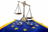 Scale of Justice, European Union flag and handcuffs
