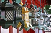 foto of suspenders  - Suspended lanterns are lined up along the wall of a temple near Kyoto Japan - JPG