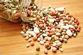picture of kidney beans  - A multiple of different dry beans spilling out of a glass jar - JPG