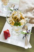 foto of pawpaw  - Delicious meringue dessert with pawpaw and passionfruit sauce with strawberries.