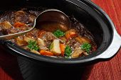 stock photo of ladle  - Photo of Irish Stew or Guinness Stew made in a crockpot or slow cooker - JPG