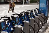 NEW YORK-MAY 25: New blue Citi Bikes lined up at the Greenwich Village station at 6th Avenue in Manh