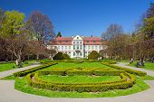 GDANSK, POLAND - MAY 6, 2013: Abbots Palace and gardens in Gdansk Oliwa on 6 May 2013. This roccoco