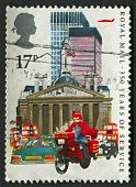 UK - CIRCA 1985: A stamp printed in UK shows image of the Datapost Motorcyclist, City of London, 350 Years of Royal Mail Public Postal Service, circa 1985.