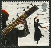 UK - CIRCA 2006: A stamp printed in UK shows image of the Bollywood and Bhangra, Sounds of Britain,