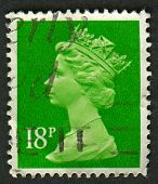 UK-CIRCA 1991:A stamp printed in UK shows image of Elizabeth II is the constitutional monarch of 16 sovereign states known as the Commonwealth realms, in Bright Green, circa 1991.