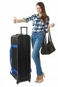 foto of 16 year old  - Teen girl 16 years old with a big black travel bag on wheels - JPG