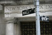 NEW YORK - MAY 30: A Wall Street street sign is shown on May 30, 2013 in New York City. The Exchange