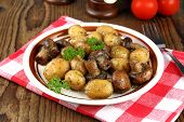 Brown Champignons With Rosemary Potato On Wood Background