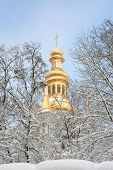 Orthodox Church And The Snow Covered Trees.
