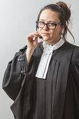 pic of toga  - thirty something brunette woman wearing a canadian lawyer toga with a telephone headset on her head - JPG