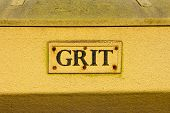 Closeup to the words on a grit container