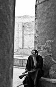 Egyptian Man Sitting By The Column