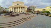 MOSCOW - OCT 20: View from unmanned quadrocopter to Bolshoi Theatre with fountain in front part and walking people on October 20, 2013 in Moscow, Russia.