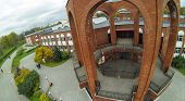 MOSCOW - OCT 9: View from unmanned quadrocopter on front place near the entrance to brick building o