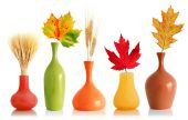 Colorful Fall Leaves And Wheat In Vases