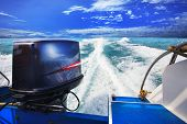 pic of boat  - rear view from speed boats running against clear sea blue water beautiful blue sky outdoor location use for traveling and nature destination theme - JPG