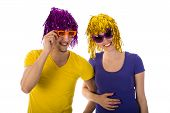 Man And Woman With Sunglasses And Carnival Wigs