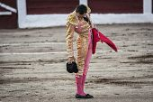 Spanish bullfighter Manuel Jesus El Cid drops his hat on the ground