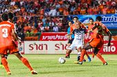 Sisaket Thailand-may 28: Therdsak Chaiman Of Chonburi Fc. (white) In Action During Thai Premier Leag